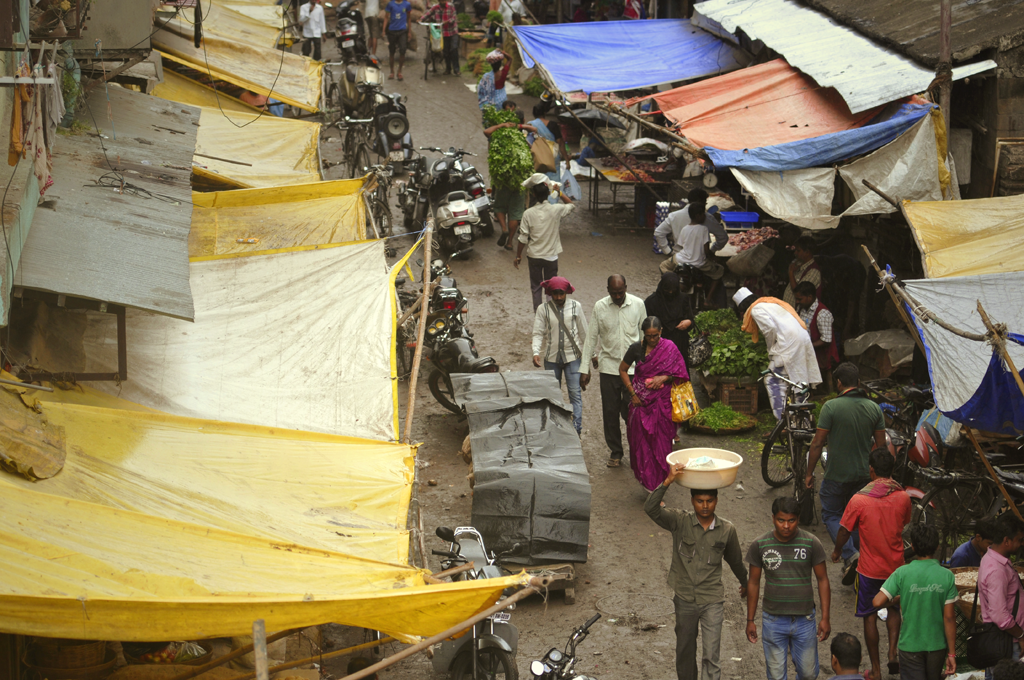People walking in the street in Byculla in India.