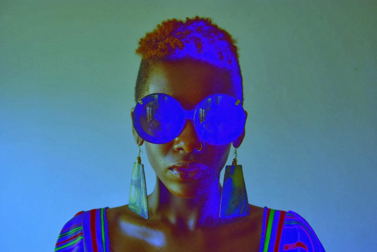 Kwesi Abbensetts: Oluwatoyin Pyne in blue glasses.