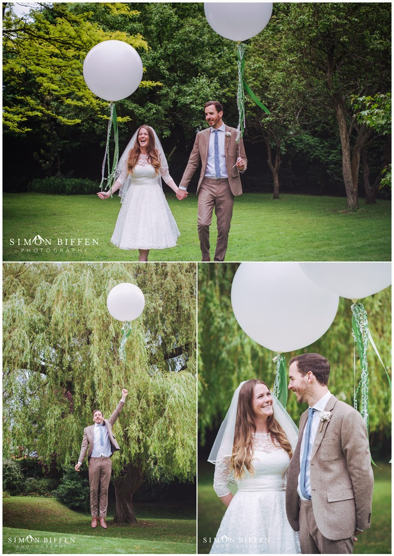 Bride and groom with helium balloons at the Ripley Arts centre