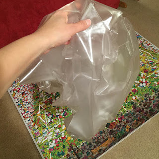 Large wad of crumpled contact paper after it was removed from the surface of a large puzzle