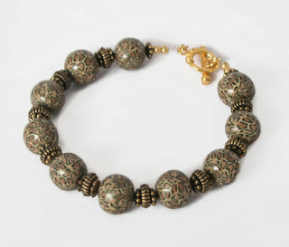 Leopard Print Beaded Bracelet handmade from polymer clay, by Lottie Of London
