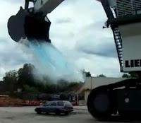 excabadora coche agua