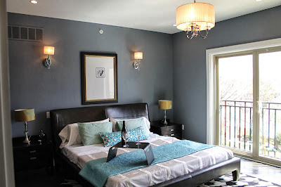 low bed design with cool black leather upholstery shows a contemporary bedroom design with unique wall decor
