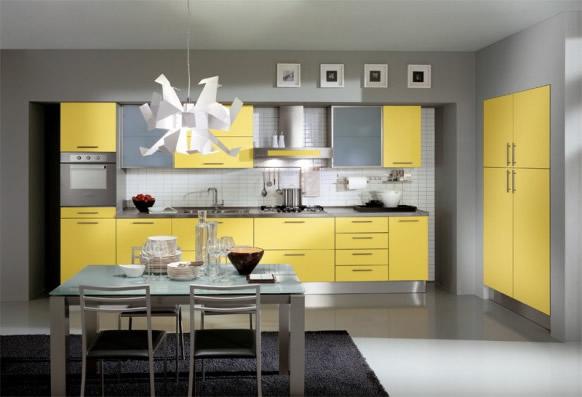 Dise?o de cocina moderna donde elegantes paredes grises sirven de