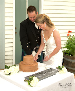Yum .. chocolate wedding cake is cut by Colin and Megan
