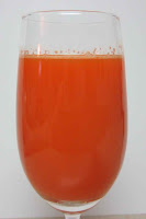 glass of fresh carrot juice