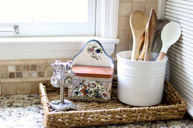 Williams Sonoma salt keeper in wicker tray on counter via www.goldenboysandme.com