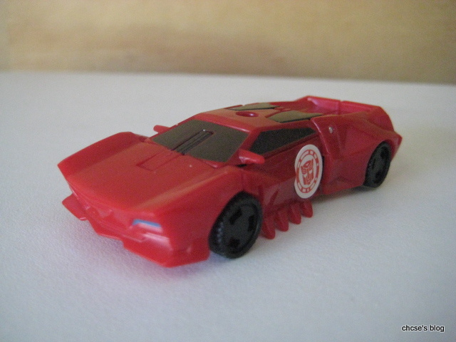 Nice True To His Original Self, Sideswipe Transforms Into A Red Sports Car, With  An Autobot Insignia On The Left Which Which You Can Scan Using The RiD App  To ...
