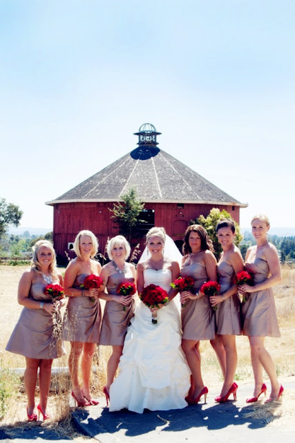 bridesmaids with red bouquets