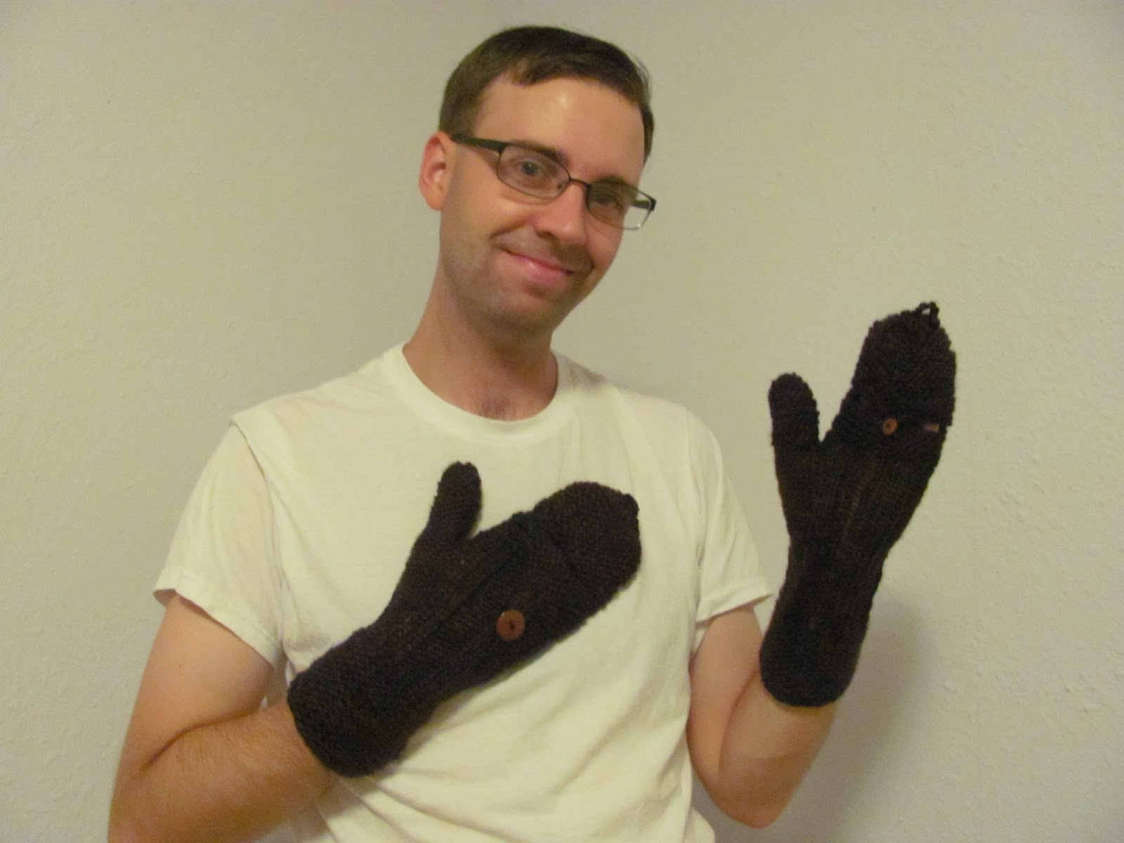 Cory posing with the brown mittens