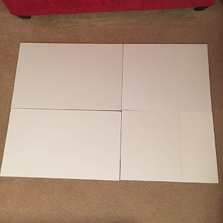 White foam core boards cut down to size to fit the back of a large puzzle
