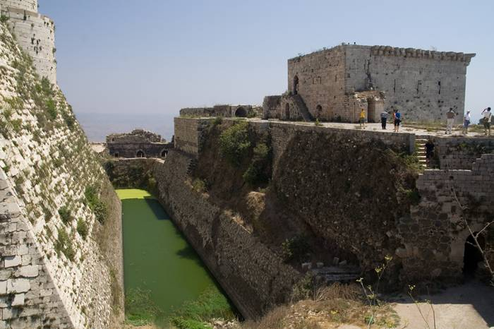 Krak des Chevaliers, also Crac des Chevaliers, is a Crusader castle in Syria and one of the most important preserved medieval castles in the world. The site was first inhabited in the 11th century by a settlement of Kurds; as a result it was known as Hisn al Akrad, meaning the