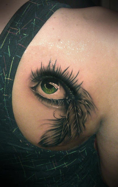 See more Realistic 3D green eye tattoos on back