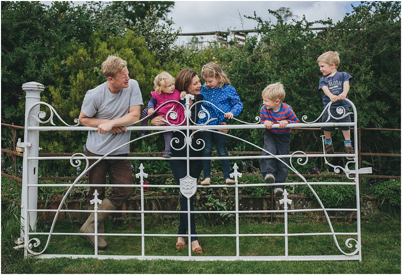The Ursell family on their gate at Windout Farm in Devon