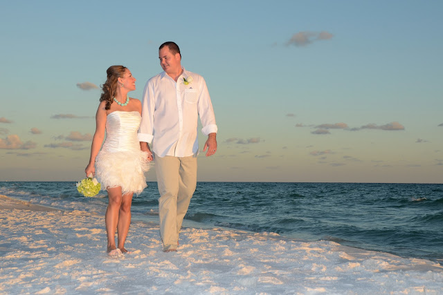 hand in hand on the beaches of Destin, Florida