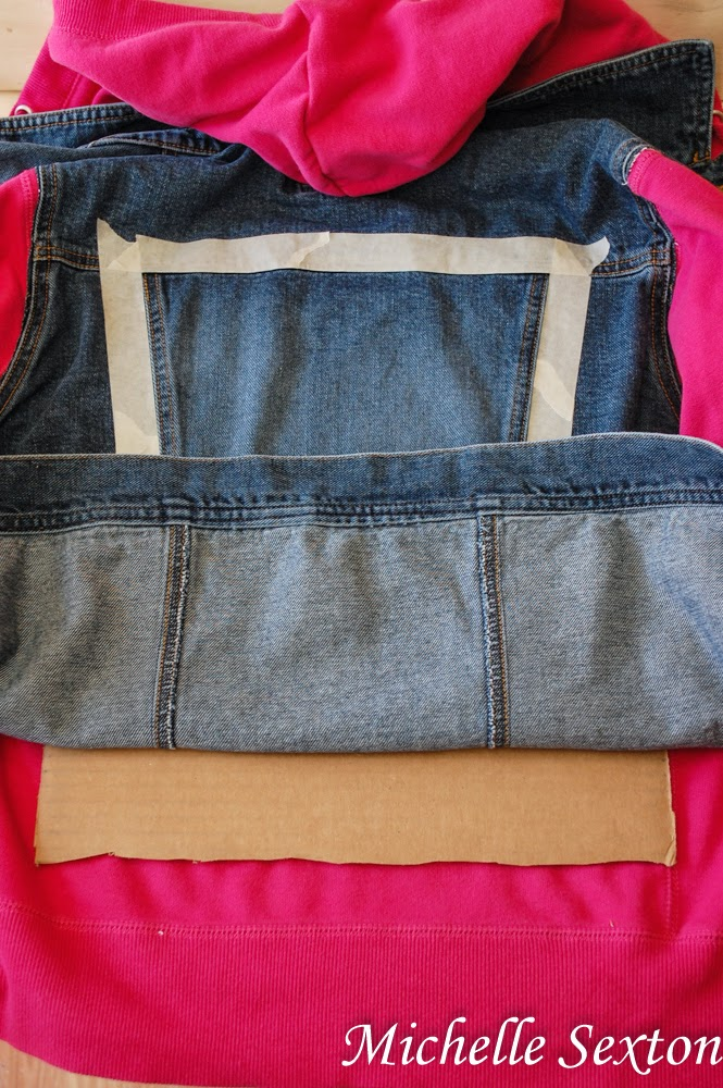 Slide a piece of unfolded cardboard underneath the denim