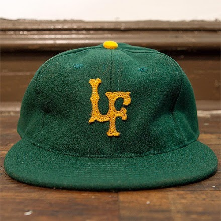 http://leftfieldnyc.com/products/forest-old-gold-fitted-ballcap