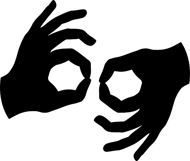 手のサインの画像
