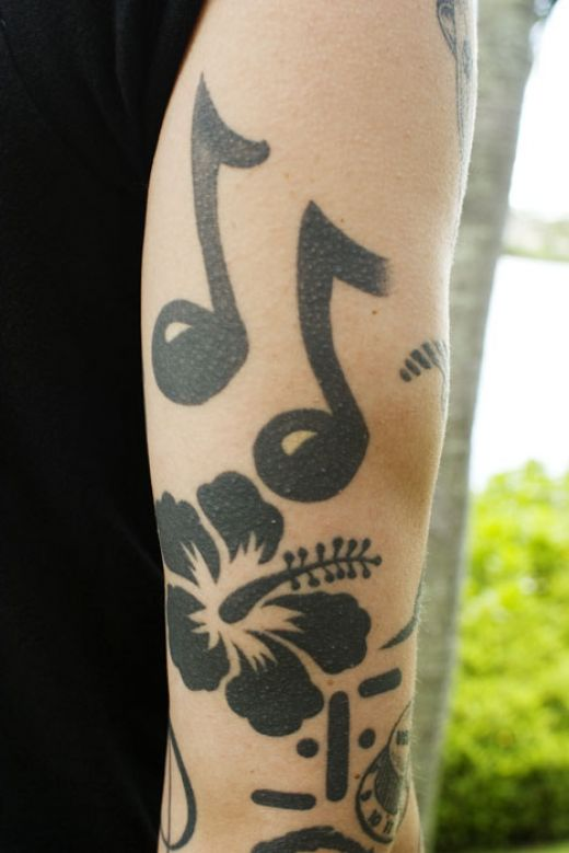 Tattoos Of Music Notes For Girls. house tattoos of music notes. music note tattoos. music notes tattoos.