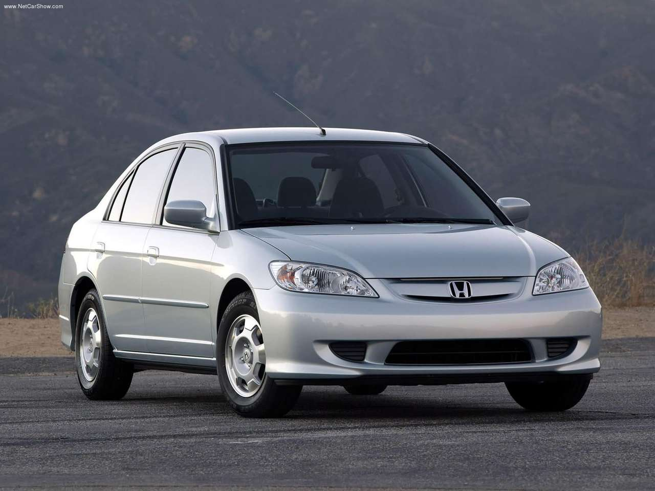 http://4.bp.blogspot.com/-19ldoijVehw/TclEJJWwBwI/AAAAAAAAGeA/Apwb3YXl79Y/s1600/Honda-Civic_Hybrid_2005_1280x960_wallpaper_01.jpg