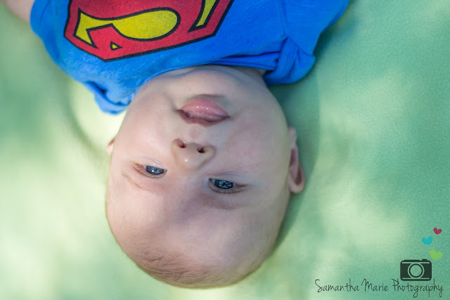 smiling baby in Superman shirt