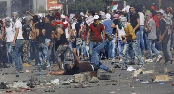Demonstran Palestina Dibunuh, Pemukim Yahudi Bagikan Manisan Dan Jus