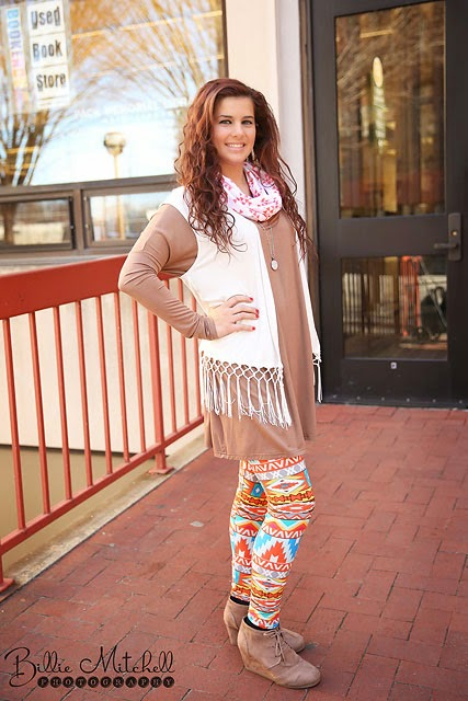 teen girl in tan tunic, printed leggings, and white fringed vest