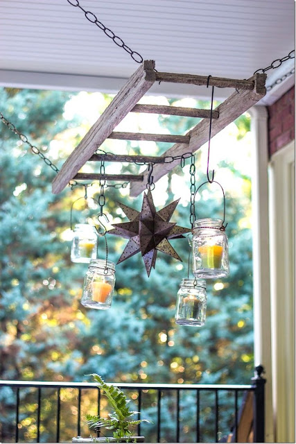 repurposed ladder with lights and lanterns