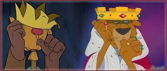 Spaventapasseri e Principe Giovanni Disney con il dito in bocca