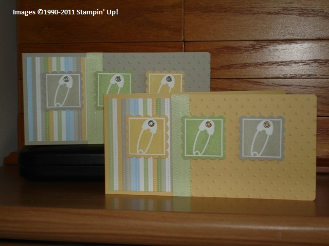 Gender-neutral baby cards with striped paper and images of diaper pins.