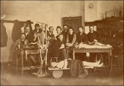 Medical Students with Skeleton and Three Cadavers - Source: http://www.nlm.nih.gov/dreamanatomy/da_g_I-D-2-13.html