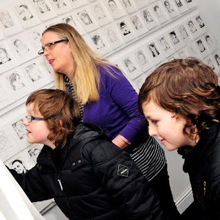 Childrens art exhibition, scottish artist, portraits, etching
