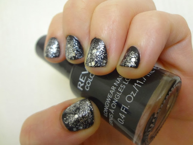 Revlon Stiletto black nail polish with silver glitter polish on top of it.