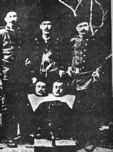 The Recognition of the genocides as the beginning of justice against the crimes against humanity and barbarity - Turkish soldiers posing proudly with heads of their victims.
