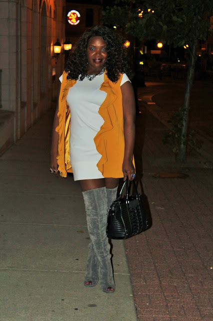 Simple-and-plain-mini-dress-styled-with-golden-ruffled-vest-and-gray-suede-over-the-knee-boots