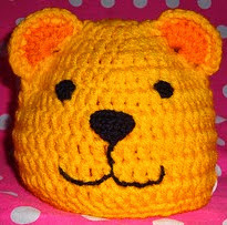 http://www.ravelry.com/patterns/library/wild-things---lion-and-bear-hats-us-terms