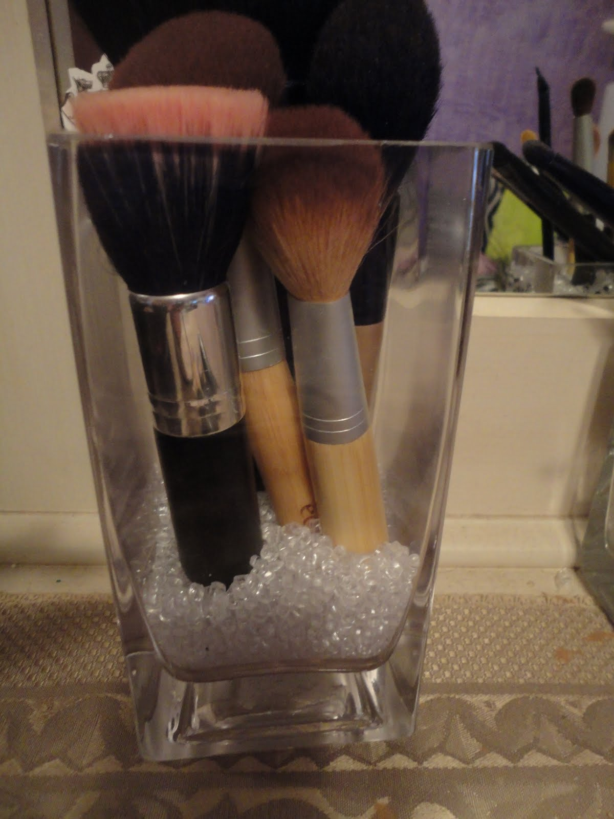 brush holder beads. this is my new brush holder which more for foundation brushes and blush brushes. i got the vase at walmart $5 some beads $3.
