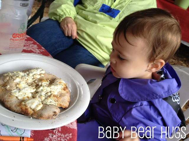 baby eating pizza made with goat cheese