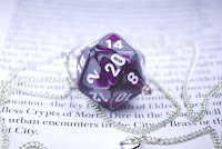 https://www.etsy.com/listing/187640494/purple-and-gray-swirl-d20-necklace?ref=related-3