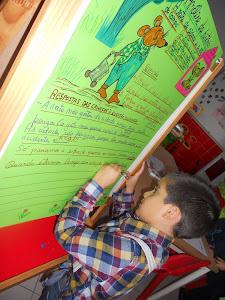 Escrever o nosso nome sob a frase que dissemos.