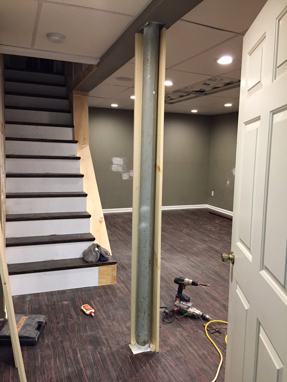 Over on dover a post about a post disguising a basement for Basement wrap