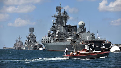 Russian Black fleet ships take part in a Russian military Navy Day parade near an important navy base in the Ukrainian town of Sevastopol, on July 31, 2011.
