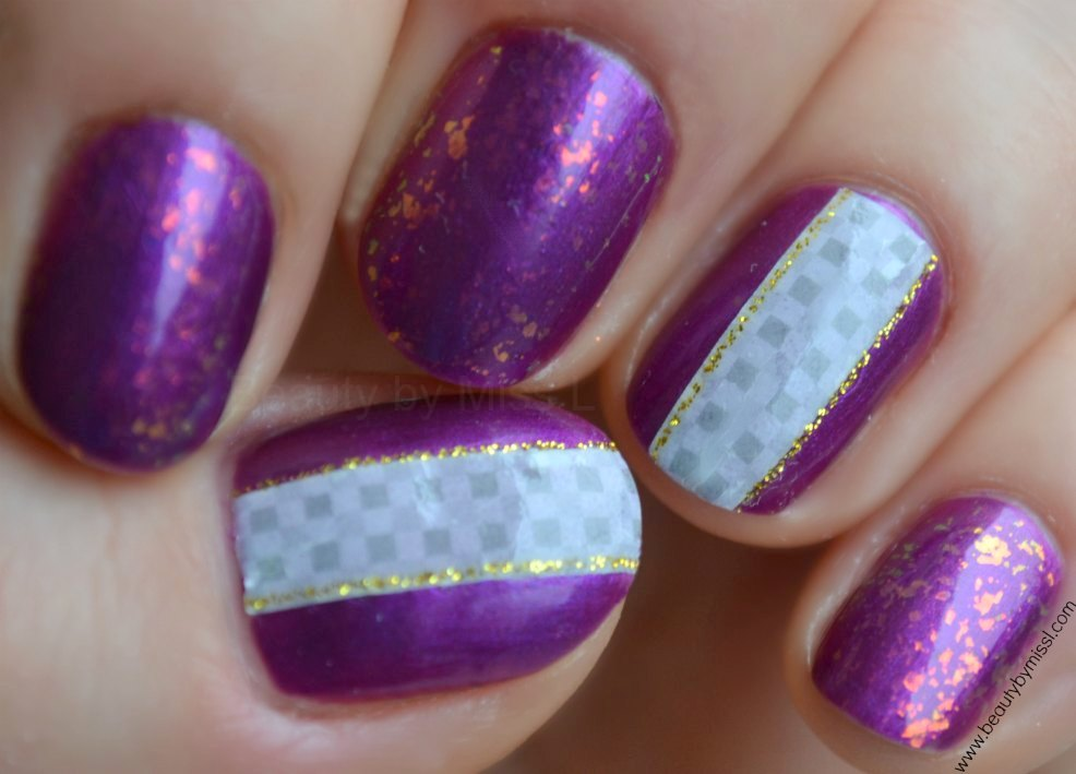 purple manicure with water decals