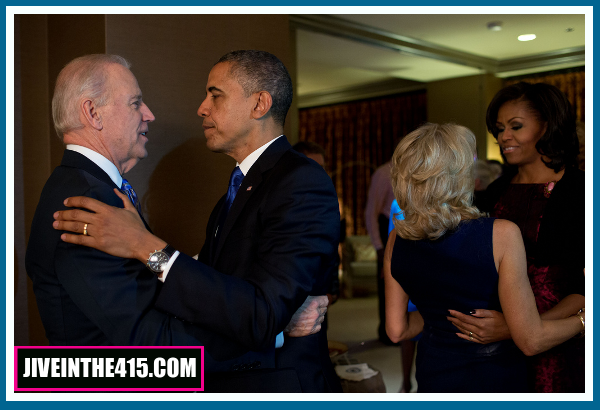 Obama and Biden embrace with their wives while watching election retuyrns in Chicago 11/06/2012.