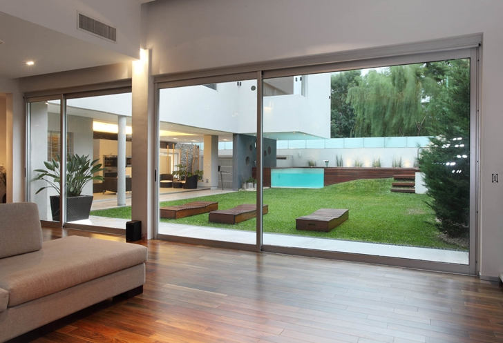 Looking out to the backyard of Modern Villa Devoto by Andres Remy Architects