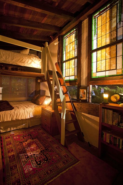 These Boho Bunks Are So Cosy Here The Stained Glass Windows Exotic Rug Candles And Books Tie Look Together