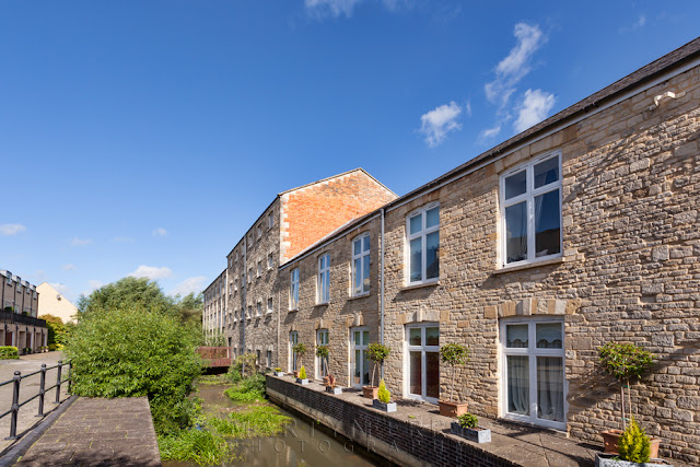 Old mill buildings now serve as residential apartments in Witney by Martyn Ferry Photography