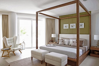 modern bedroom in white that has beautiful furnishings and direct access to the porch