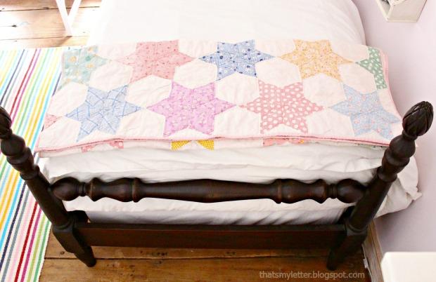 vintage quilt on girls bed
