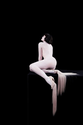 Nina Khazani, nude model with high heel shoes made out of human hair